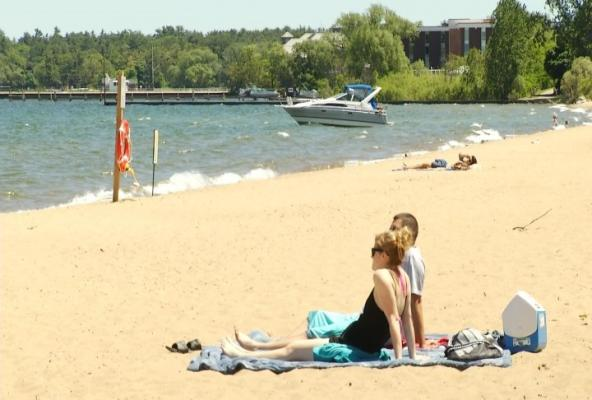 ON THE BEACH • Michigan Beach Closures Indicative of Over Development and Inadequate Sewage Treatment
